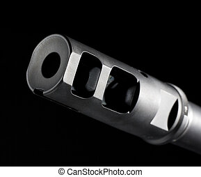 Flash hider on the end of the barrel on an assault rifle