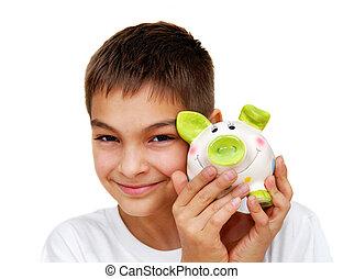 Teenage boy with piggy money box