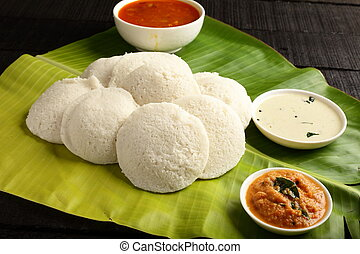 Homemade spongy Idli served in banana leaf - Homemade...