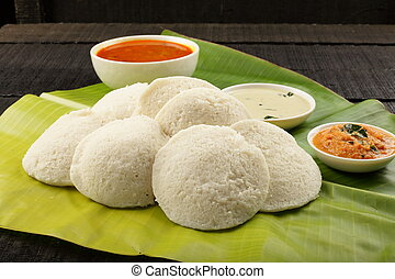 Fresh spongy Idli served in banana leaf - Homemade...