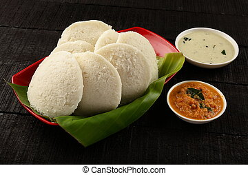 Homemade idli served with sambar and chutney, - Homemade...