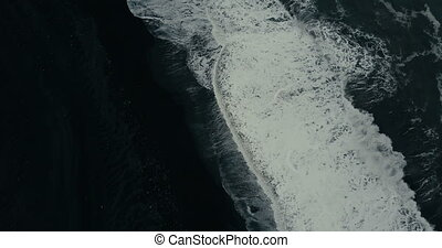 Aerial top view of the powerful wave with foam coming on the...