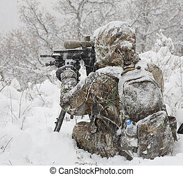Cold weather hunter - Hunter in camouflage that is behind a...