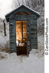 Cold bathroom - Out house in the backcountry that is covered...