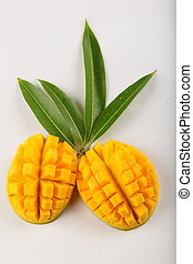 Delicious juicy mango slices on white background with fresh...
