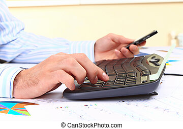 Young man working on computer at office