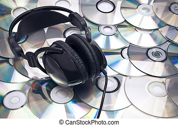 CDs background and headphones - Black headphones on cd...