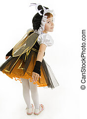 Small girl is dressed at bee costume