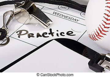 Baseball practice - A silver whistle laying on a calendar...