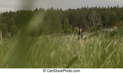 Face of hippie woman in field - Face of beautiful woman in...