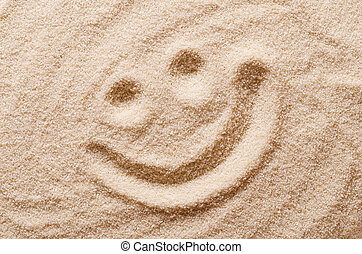 Happy smiling face in the sand macro photo - Happy smiling...