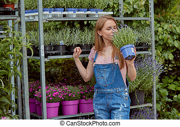 Excited woman with potted flower - Horizontal outdoors shot...