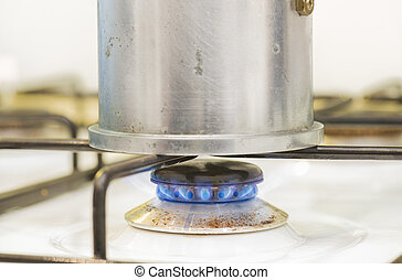 coffee pot on the stove with fire
