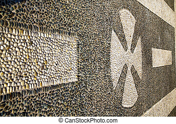 in the castano varese abstract pavement of a curch and...