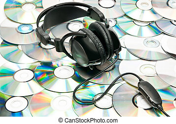 Headphones - Black headphones on dvd background