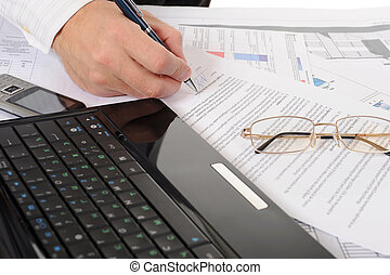 business person hands working with document - Close-up of...