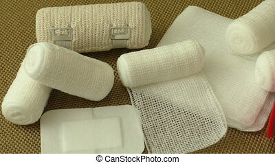 Bandages and plasters on a gold background
