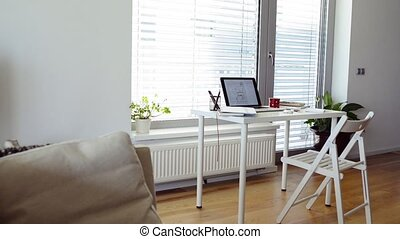 Home office. Desk with various gadgets and office objects. -...