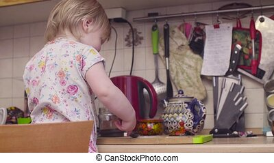 Little baby girl playing in the kitchen - Happy little baby...