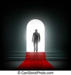 Man goes to the light on the red carpet.