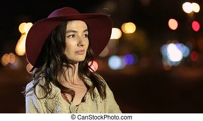 Elegant charming woman smiling in night city - Stylish...