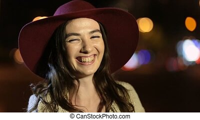 Portrait of joyful girl laughing in night street - Portrait...