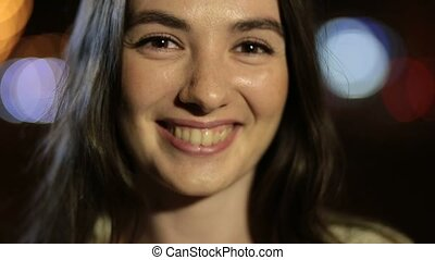 Fashionable woman with perfect smile in night city - Closeup...