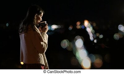 Gorgeous woman enjoying night city lights - Profile of young...