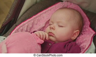 Adorable Sleeping Baby on a pink blanket