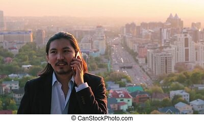 Professional asian businessman talking over a phone against...