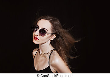 Young woman wearing a sunglasses