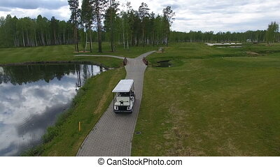 Cart in the golf club - From above golf cart riding near...
