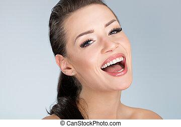 Young beautiful woman laughing