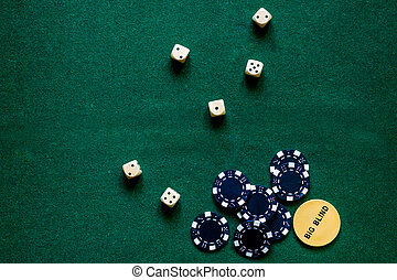 Poker chips and the dice on a green gaming table top view copyspace