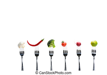 fresh vegetables on forks isolated on white, healthy living concept