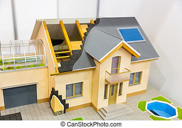 Model of house, thermal insulation of roof concept. Energy...