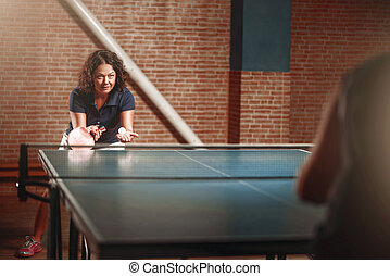 Table tennis, female player with racket on serve