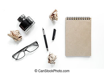 Writer concept. Glasses, pen and notebook on white background top view mockup