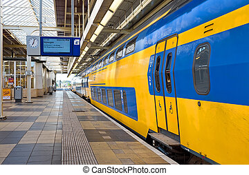 Train departing from Amstel station in Amsterdam the...