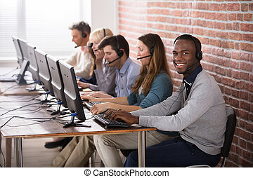 Call Center Team - Young Call Center Team Talking With...