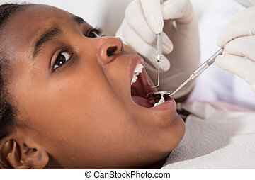 African Girl With Mouth Open During Oral Checkup