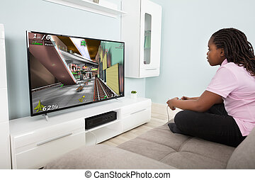 Girl Playing Video Game With Joysticks - Girl Sitting On...