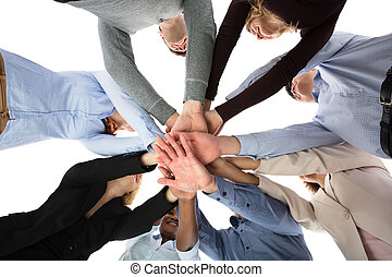 Group Of College Students Stacking Their Hands