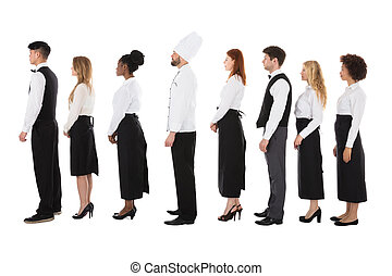 Multiracial Restaurant Staff Standing In Row Over White...