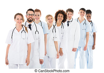 Happy Medical Team With Stethoscope Standing In Row