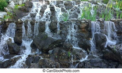 Artificial waterfall in the garden.