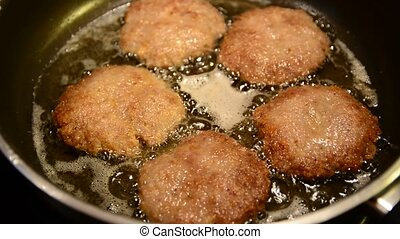 Frying patties - Close up of a frying five minced meat...