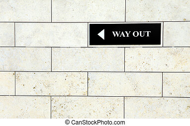 Way out sign - Black way out sign on the white wall