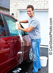 Man washing the car - Smiling happy man washing the red car