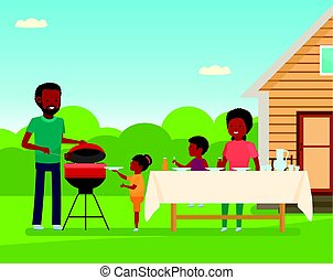 African Happy family preparing a barbecue grill outdoors....